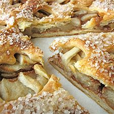 This low-profile apple pie features a thin layer of cinnamon-scented apples between two flaky, sugar-topped crusts.