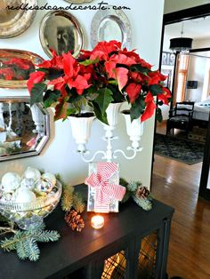 DIY Poinsettia Candelabra by Redhead Can Decorate (made from ceiling fan light glass shades)