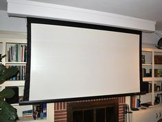for our next living room: roll-up screen in from of book shelves, projector. SPACE SAVER!