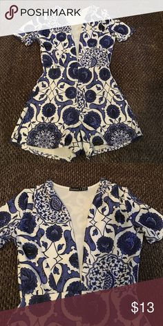 Beautiful romper  Amazing romper! So so cute, brand new never worn just took off tags in love with this piece but didn't fit Boohoo Petite Dresses