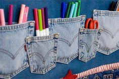 Old jean pockets for little holders on the wall! Super cute and a great idea!