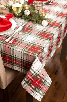 Decorate for the holiday season with traditional plaid in classic Christmas duos of red and green to bring good tidings and cheer to your dinner table. #hosting #guests #lowes #Christmas #tablescape