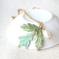 Vintage patina leaf necklace with white pearl