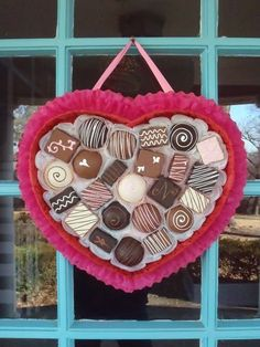 "DIY ""Box of Chocolates"" Valentine Wreath for the front door...using crepe paper, foam core & styrofoam balls and paint...too cute!!"