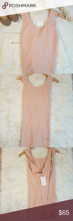 Theory Top Blush Theory Top. Criss Cross In The Back. Size Large. 70% Triacetate 30% Polyester. Perfect Staple For Anyone's Wardrobe!  *Please note that everything is second hand unless stated otherwise.* Theory Tops