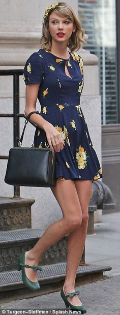 Stepping into spring: The singer left her New York apartment in the stylish outfit, which left her legs on show