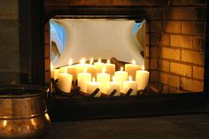 Perfect for warm weather or a non-functional fireplace. The mirrored fireback really reflects the flickering candles.