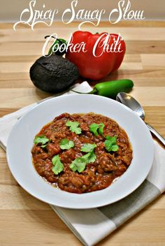 Spicy Saucy Slow Cooker Chili will certainly warm you up on any night. Just throw all the ingredients in your slow cooker and 8 hours later you will have bellyful of spicy, yummy goodness that you can feel good about too! Go ahead and get that second helping! Get this recipe right here and your next meal will be taken care of!