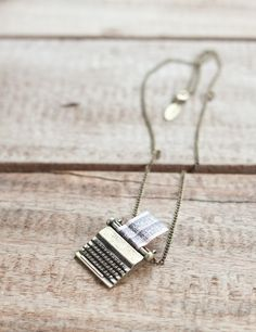 Vintage style Antique style gold plated necklace with typewriter charm.The necklace features a detailed keyboard and a pink sheet of paper decorated with tiny writing. The perfect gift.  Rose & Grey (UK)  This is SO CUTE!!  Just can't imagine the shipping from the UK.  Putting on my Christmas list anyway!