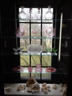 2014 photo: Threaded Sandwich Glass and seashells from the Durand collection housed in the Durand room at Atwood House Museum, Chatham, MA. #sandwhichglass, #chathamhistoricalsociety, #atwoodhouse, #glass, #chatham, #capecod, #durandroom