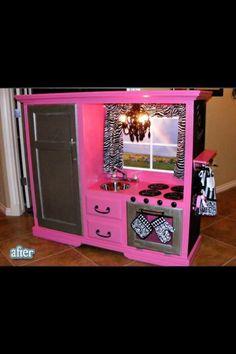 Old entertainment center converted into kids kitchen.