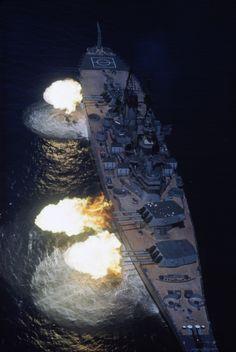 Battleship New Jersey, Gun Salvo Aerial of the USS New Jersey battleship firing a nine gun salvo from the Gulf of Tonkin. North Vietnam 10/1968