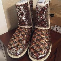 Uggs Classic Short Sparkle/Sequin Boots. NWT Beautiful star-like sequins, shimmering metallic bottoms with the comfort and warmth of the sheepskin lined inside. Pull on with round toe...made to be worn without socks. UGG Shoes Winter & Rain Boots