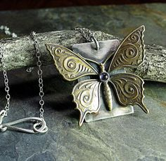 A sweet art noveau style butterfly pendant with iolite    ...from Lavender Cottage on Etsy
