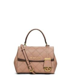 A touch of fresh, refined style for your work-to-weekend wardrobe. Quilted stitching punctuates the soft yet structured shape of this satchel with ladylike appeal, playing beautifully against the texture of its Saffiano leather. We especially love how this bag looks with minimalist tailoring and neutrally hued dresses.