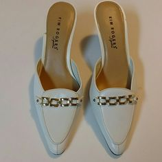 Kim Rogers signature slip on heals. Kim Rogers size 7, medium. With 3 1/2 inch heels. White with gold buckle chain on front. Wood colored heels. Kim Rogers Shoes Flats & Loafers