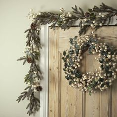 white glitter berry christmas wreath or garland by the christmas home | notonthehighstreet.com