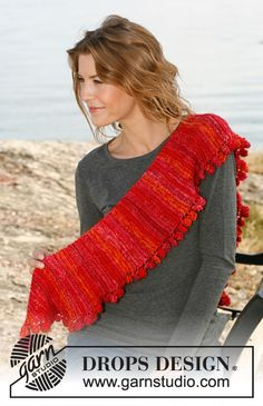 "Knitted DROPS scarf in garter st with short rows and bobbles along the edge in ""Fabel"" or Flora and ""Kid-Silk""."
