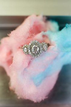 Vintage-inspired filigree detailing and a glamorous three-stone halo combine to form this jaw-dropping ring.
