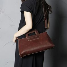 Handmade Leather Cross-Body Bag by Elen Rose Material:LeatherDimensions: L37cm x H18cm x D9cmDetail: Removable shoulder strap.
