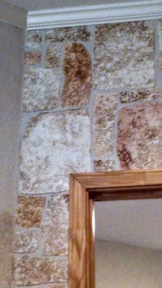 closeup of my Texas Stone, faux rock I make out of paintable, textured wallpaper.  I tear each rock, hand paint (takes about 10 seconds) and then apply to wall.  I finish with a mudwash sealer of Draw-tite and drywall mud. Fun.