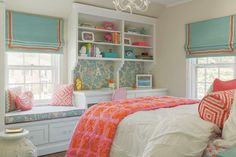 Built in window seat, desk and shelving. Very nice decor for teen.