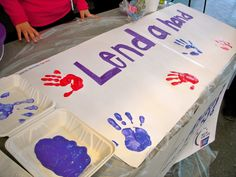 As part of a fundraiser Relay for Life this spring, Brandeis community members decorate a banner and donate to a good cause