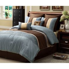 Add some comfort and style to your bedroom d�cor with this striped eight-piece comforter set in blue and brown. Featuring a simple classic style appropriate for men or women, this set includes a comforter, bedskirt, pillows, and shams.