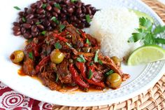"Shredded beef and vegetables that resemble a heap of colorful rags  – that's Ropa Vieja.  From the Spanish term for ""old clothes"", this is one of Cuba's most popular and beloved dishes.  So popular in…Continue reading →"