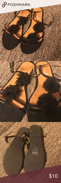H & M Sandals Black H&M Sandals with tulle flowers on them. These have been worn once and are great for resort vacations. In great condition and from a smoke free home. H&M Shoes Sandals