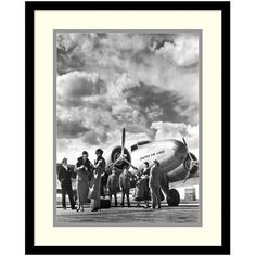 ''Passenger At Aviation Field At Newark NJ 1940s'' Framed Wall Art ($220) ❤️ liked on Polyvore featuring home, home decor, wall art, black, black framed wall art, vertical wall art, black wall art, black home decor and framed wall art