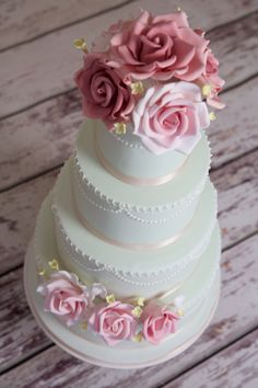 Mint green and pink wedding cake with open roses