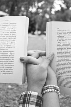 Hold hands and reading. This is a must for the next photo shoot for Chris and I!