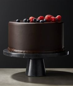 chic sweets. honed black marble cake stand makes a luxe statement supporting a cake or simply on display. clean graphic shape lets the marble take center stage. cb2 exclusive.