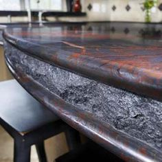 Iron Red granite countertop. What an amazing edge detail! Chiseled edge combined with bullnose to make a sandwich.