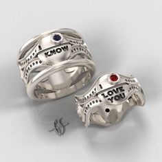 Totally using these for my wedding someday. His and Hers Star Wars Ring Set - Sterling Silver with Rubies and Sapphire. $940.00, via Etsy.