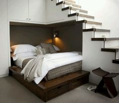 Great idea for empty stair space in a small basement.