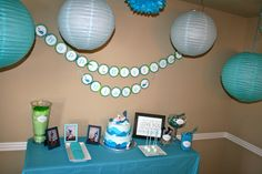 Blue dessert table for baby boys first birthday