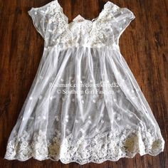 FREE PEOPLE Dress Lace Embroidered Eyelet Slip Top Size XS.   New with tags.  $168 Retail + Tax.   Embroidered off-white swing dress with sheer shell.  Removable ivory mini slip lining included.  Lace detailing at chest & bottom hem. Button opening at back.  Nylon.  Imported.    ❗️ Please - no trades, PP, holds, or Modeling.    Bundle 2+ items for a 20% discount!    Stop by my closet for even more items from this brand!  ✔️ Items are priced to sell, however reasonable offers will be…