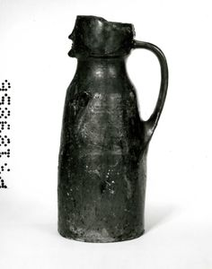 Early 14th century face jug from Worcester Cathedral in the British Museum collection. ID no. 1974,1001.1. Height: 39.7 cm.
