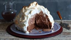 A simple chocolate cake topped with your choice of ice cream – which is then smothered with soft meringue and lashings of chocolate sauce. Surely this 70s classic is due a revival? Equipment and preparation: you will need a 1 litre/1¾ pint pudding basin (20cm/8in in diameter), a 20cm/8in round cake tin and a flat baking tray.