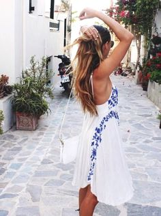 An embroidered dress and a dreamy backdrop.