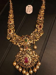 Stunning gold long haaram with flower design pendant. Long haaram studded with diamonds rubies and emeralds. Long haaram with south sea pearl hangings. Gold Jewellery Design, Gold Jewelry, Fine Jewelry, Gold Bangles, Resin Jewelry, Gold Necklaces, Black Jewelry, Dainty Jewelry, Turquoise Jewelry