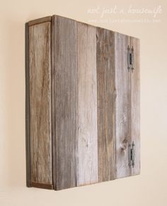Take a look at this cupboard made out of old fence pickets. Stacy, of Not Just a Housewife, repurposed the wood and with a little help from #Minwax Wood Finish in Weathered Oak, she got the look she wanted.   #DIY #WoodPallets #HomeDecor