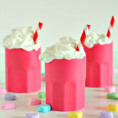 Shot glasses made of (tinted) white chocolate filled with spicy vodka and topped with whipped cream and sprinkles.  Yah HOO!  ;-)