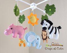 "Nursery Jungle Crib Mobile ""Safari Playland"" Mobile - Elephant, Lion, Giraffe, Zebra, Hippo. $80.00 from Etsy."