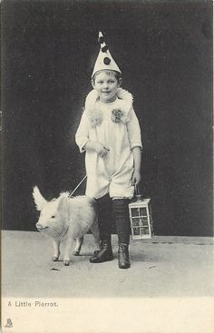 A petit Pierrot and a piglet