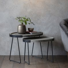 A peaceful addition to your home, the metal and wood Salem nesting side table in grey is ideal for your living room. The subtle contrast in grey tones gives industrial style notes that complement contemporary and modern interiors perfectly. Minimalist metal legs and a curving top make it great for keeping by the sofa or armchair.