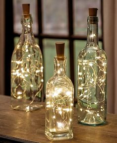 Give new life to your empty wine bottles with a Set of 3 Wine Bottle Stopper String Lights. These lights transform any bottle into a romantic mood light, w # diy wedding decorations Sets of 3 Wine Bottle Stopper String Lights Wine Bottle Stoppers, Wine Bottle Crafts, Wine Bottle Corks, Wine Decanter, Alcohol Bottle Crafts, Wine Bottle Flowers, Diy Bottle, Our Wedding, Dream Wedding