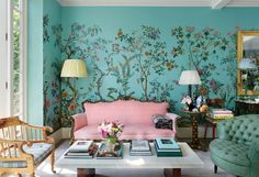 """The couple's London living room, which features a custom botanical mural scene by Zuber and a marble coffee table of their own design."" Photography by Oberto Gili. ""A Look Inside Caroline Sieber's London Home"" by Hamish Bowles. Rosa Couch, London Living Room, Room London, London House, Decoration Chic, Pink Couch, Pink Settee, London Townhouse, Inspirational Wallpapers"